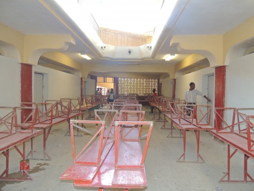The final parging of our building has been done.  The inside walls and most of the outside walls are finished. Gill, co-owner of Authentic Haiti, did a wonderful job.   It looks so great and we are so thankful.  All we need to do now is to paint the walls.  The picture shows our temporary cafeteria. The pool of light on the top of the picture gives on the sanctuary.